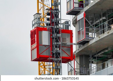 Elevator lifts for workers and material at the construction site.