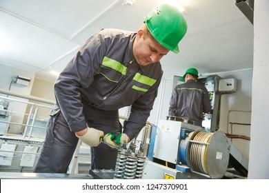 elevator machinist make maintenance in engine room