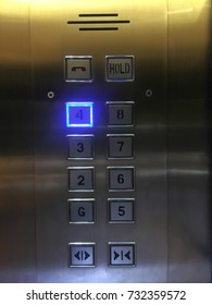 Elevator panel with buttons and LED light.
