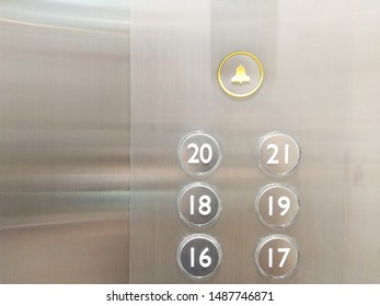 Elevator push-up and down buttons on different floors, bell shaped symbols for help