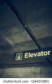 Elevator sign in parking garage (Vertical Frame).