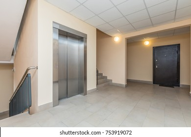 Elevator and stairs up and down in a modern elegant building