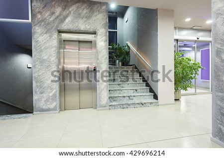 Elevator And Stairs In A Modern Elegant Building