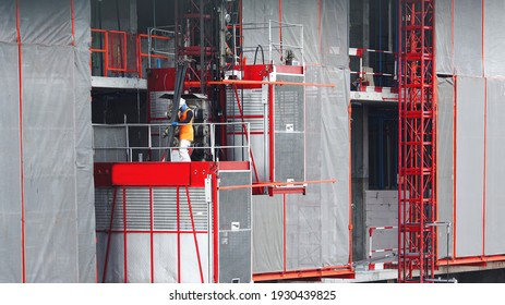 Elevators used for worker and moving materials in Construction site, Passenger lift system outdoor on industrial buildings, Construction activity of worker, Development land and residential in city.