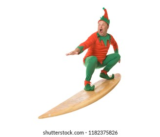 An elf on a surfboard, isolated on white.