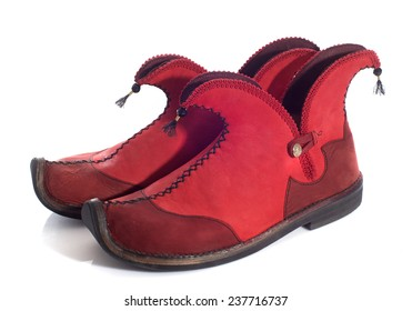 elf shoes in front of white background