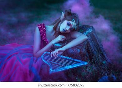 Elf woman in violet dress