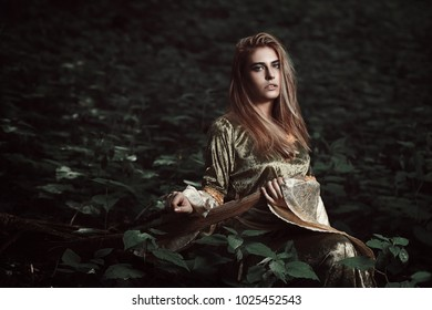 Elfin girl in magical forest. Fantasy and fairy