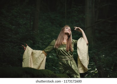 Elfin queen dancing in magical woods. Fairytale and fantasy