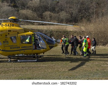 ELGIN, MORAY, SCOTLAND - 16 MARCH: This is a National Health Service, Air Ambulance at a Motocross event in Elgin, Moray, Scotland to uplift a patient after a motorcycle crash on 16 March 2014.