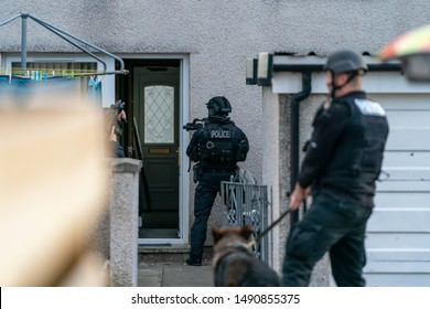 ELGIN, MORAY, SCOTLAND - 20 AUGUST 2019: This is the Police Firearms Officers conducting a raid on a house within Elgin in order to arrest a Wanted Person.