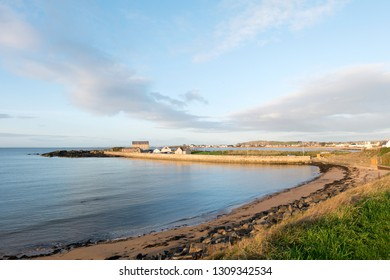 Elie harbour and Wood Haven Beach  from the Fife Coastal Path at Ruby Bay, Elie, Fife, Scotland.