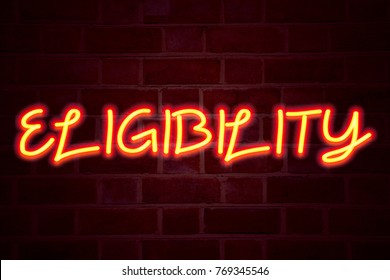 Eligibility neon sign on brick wall background. Fluorescent Neon tube Sign on brickwork Business concept for Suitable Eligible Eligibility.