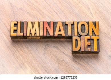 elimination diet word abstract in vintage letterpress wood type printing blocks