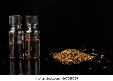 E-liquids next to pile of grinded tobacco leaves