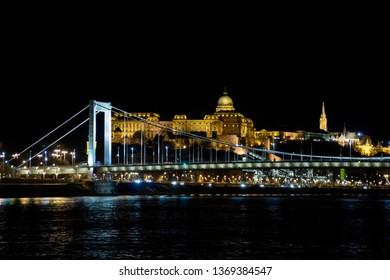 Elisabeth bridge and Buda Castle at night from the Danube river in Budapest, Hungary, Europe