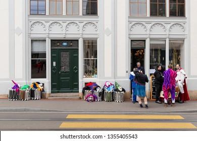 Elisabethenstrasse, Basel, Switzerland - March 12th, 2019. Carnival participants having a break before marching on