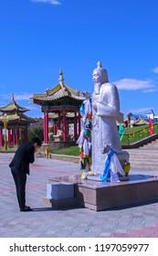 Elista, Kalmykia - 16 Sep 2016: Buddhist temple (Golden Abode of Buddha Shakyamuni), one of world residences of Dalai Lama. People praying statue of Sagaan Ubgen (White Old Man), guardian of life