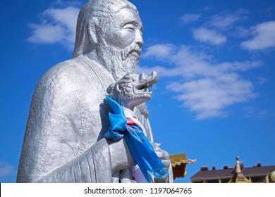 Elista, Kalmykia - 16 Sep 2016: Statue of Sagaan Ubgen (White Old Man), guardian of life & prosperity, near temple Golden Abode of Buddha Shakyamuni (one of world residences of Dalai Lama). Closeup