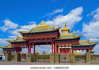 Elista, Kalmykia - 16 Sep 2016: Gate of Buddhist temple, one of world residences of Dalai Lama. Words: 'Golden Abode of Buddha Shakyamuni'