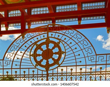 Elista, Kalmykia - 16 Sep 2016: Gate of Buddhist temple, one of world residences of Dalai Lama. Image of wheel of dharma