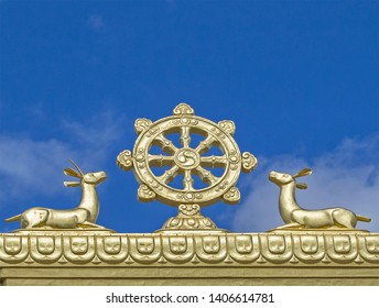 Elista, Kalmykia - 16 Sep 2016: Gate of Buddhist temple, one of world residences of Dalai Lama. Image of golden wheel of dharma & two deers