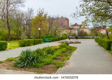 Elista, Kalmykia / Russia - 24 april 2019. The walkway in the Pushkin's park in the Elista with Pushkin sculpture.