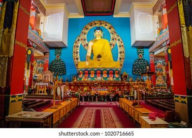 ELISTA, KALMYKIA, RUSSIA - APRIL 24, 2017: Buddhist temple interior. Statue of seated Buddha in the Temple Golden Abode of Buddha Shakyamuni
