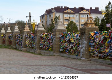 Elista, Russia: 04.19.2019. Buddhist complex Golden Abode of Buddha Shakyamuni in Kalmykia (Great Hurul). Color Buddhist prayful tags on the fence