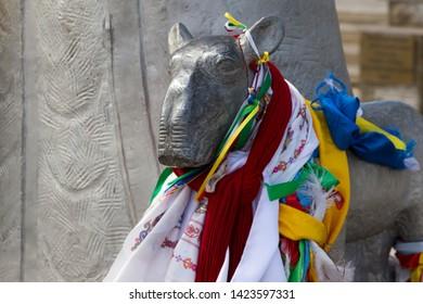 Elista, Russia: 04.19.2019. Buddhist complex Golden Abode of Buddha Shakyamuni in Kalmykia (Great Hurul). Saiga statue with color Buddhist prayful tags