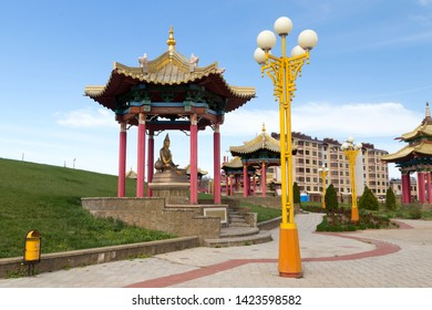 Elista, Russia: 04.19.2019. Buddhist complex Golden Abode of Buddha Shakyamuni in Kalmykia (Great Hurul). Statues of buddhism teachers in the park in front of the building