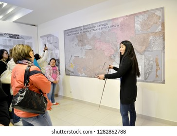 """ELISTA, RUSSIA - APRIL 22, 2017: The guide in museum department """"Operation """"Uluses"""""""". National museum of Kalmykia of N.N. Palmov. The Russian text - Deportation of the Kalmyk people"""
