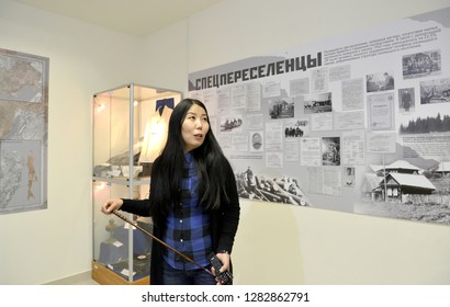 """ELISTA, RUSSIA - APRIL 22, 2017: The girl guide in museum department """"Deportation of the Kalmyk people"""". National museum of Kalmykia of N.N. Palmov. The Russian text - Special immigrants"""