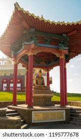 "Elista, Russia - September 12, 2017: Pagoda with statue of great teacher Shantideva near Buddhist temple ""Golden Abode of Buddha Shakyamuni"". Republic of Kalmykia."
