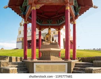 "Elista, Russia - September 12, 2017: Pagoda with statue of great teacher Gunaprabha near Buddhist temple ""Golden Abode of Buddha Shakyamuni"". Republic of Kalmykia."