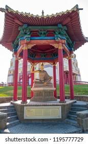 "Elista, Russia - September 12, 2017: Pagoda with statue of great teacher Chandrakirti near Buddhist temple ""Golden Abode of Buddha Shakyamuni"". Republic of Kalmykia."