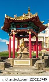 "Elista, Russia - September 12, 2017: Pagoda with statue of great teacher Dharmakirti near Buddhist temple ""Golden Abode of Buddha Shakyamuni"". Republic of Kalmykia."