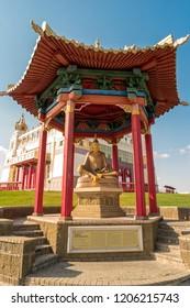 "Elista, Russia - September 12, 2017: Pagoda with statue of great teacher Santaraksita near Buddhist temple ""Golden Abode of Buddha Shakyamuni"". Republic of Kalmykia."