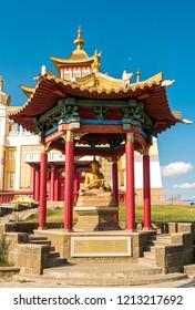 "Elista, Russia - September 12, 2017: Pagoda with statue of great teacher Haribhadra near Buddhist temple ""Golden Abode of Buddha Shakyamuni"". Republic of Kalmykia."