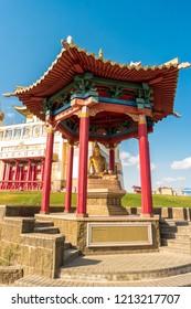"Elista, Russia - September 12, 2017: Pagoda with statue of great teacher Vimuktisena near Buddhist temple ""Golden Abode of Buddha Shakyamuni"". Republic of Kalmykia."