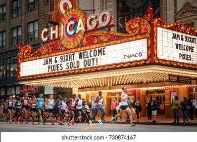 Elite athletes, including winner Galen Rupp, pass the Chicago Theatre near the start of the Chicago Marathon in Chicago, Illinois October 8, 2017. The marathon is one of the 6 World Marathon Majors.