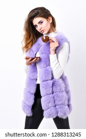 Elite coffee concept. Pretty lady drink coffee little ceramic cup white background. Enjoy aroma and taste hot coffee. Elite drink with caffeine. Woman makeup wear luxurious fur coat drink hot coffee.