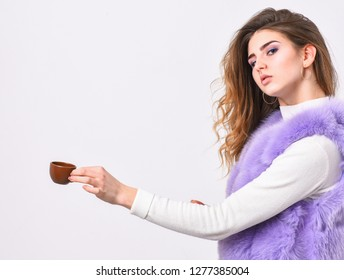 Elite coffee concept. Elite coffee variety concept. Lady drink espresso little ceramic cup white background. Elite drink with caffeine. Enjoy aroma and taste hot coffee. Woman fur coat drink coffee.