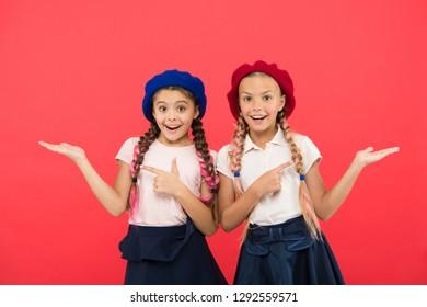 Elite school college. Education abroad. Apply form enter international school. Sisters friends girls. French language school. School fashion concept. Schoolgirls wear formal uniform and beret hats.