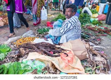 Eliya / Sri Lanka - March 19 2017: Merchants selling vegetables in the food market in Sri Lanka. People selling fresh vegetables, fruits, fish on a food market in asia.