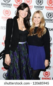 """Eliza Bennett and Daisy Lowe arriving for the """"Confine"""" premiere as part of the Raindance Festival 2012 at the Apollo Cinema, London. 29/09/2012 Picture by: Steve Vas"""
