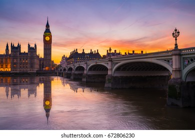 Elizabeth clock known as Big Ben and Westminster bridge with water reflection at dusk, London, England