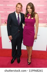 Elizabeth Hurley aka Liz Hurley and Shane Warne at the Estee Lauder's Breast Cancer awareness campaign in Selfridges, London. 08/10/2012 Picture by: Henry Harris