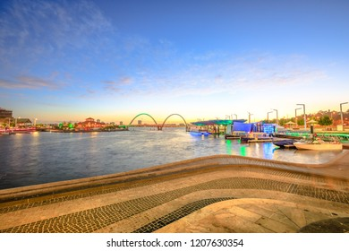 Elizabeth Quay Marina with docked boats and sunset light. Perth Waterfront Cityscape, WA, Australia. The iconic Elizabeth Quay Bridge on Swan River on background. Copy space.