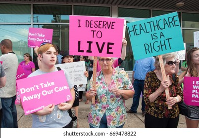 Elizabethtown, Kentucky – June 30, 2017:  Protesters rally in opposition of republican Senator Mitch McConnell and the republican health care bill in Elizabethtown, Kentucky, on June 30, 2017.